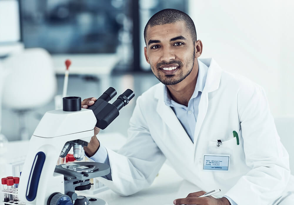 Male doctor with microscope