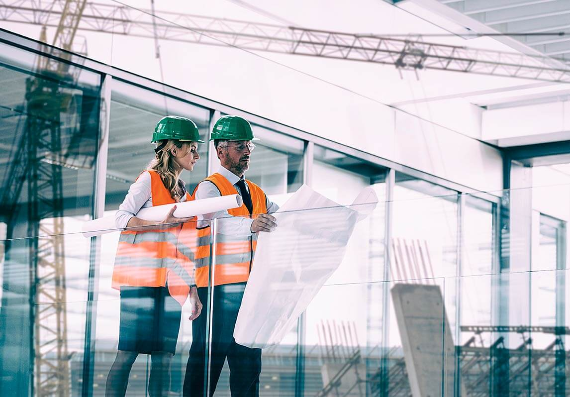 Male and female wearing construction hats