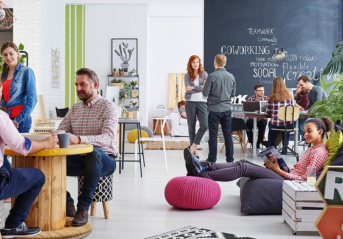 Business people relaxing in a stylish office environment